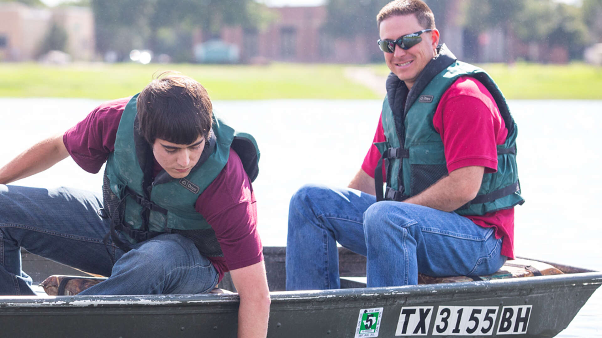 Dr. Bart Durham and student in boat