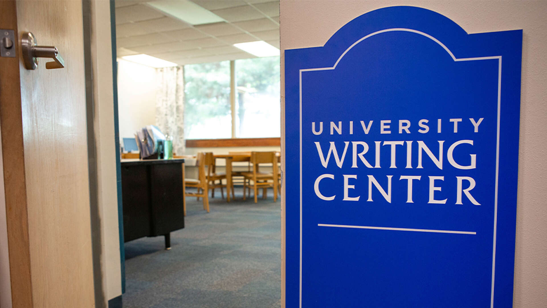 University Writing Center sign by open door of office