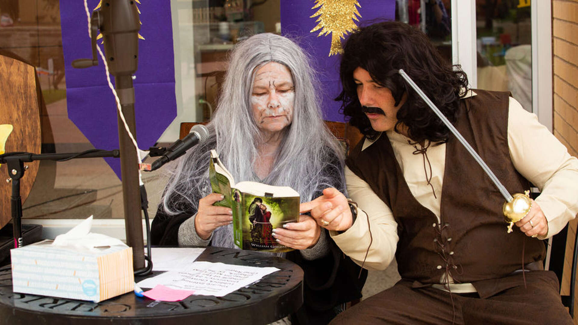"Dr. Carole Carroll and Dean of Students, Josh Stephens, in costume reading ""The Princess Bride"""
