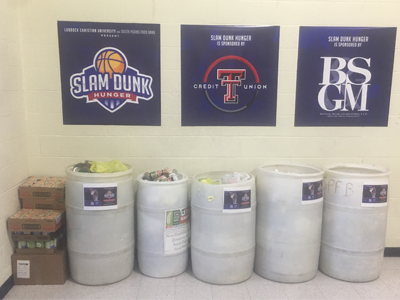 Barrels of can donations at the event
