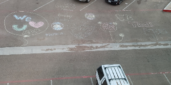 Chalk drawing on hotel parking lot