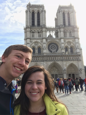 Couple standing in front of the Notre Dame Cathedral, Paris, France