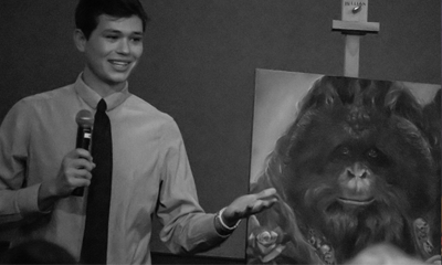 Student in front of orangutan painting